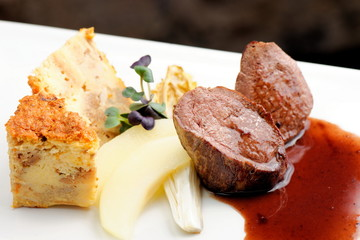 Venison meat steak with Quiche pie, Port Sauce,herbs and Potato