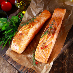 Grilled salmon steaks seasoned with herbs