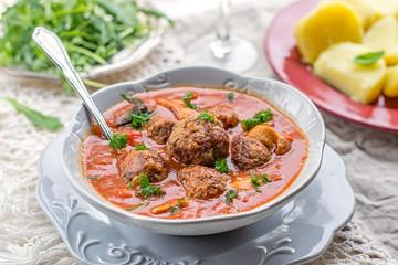 Meatballs albondigas in tomato sauce with mushrooms