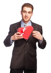 Man in suit with a heart-shaped gift