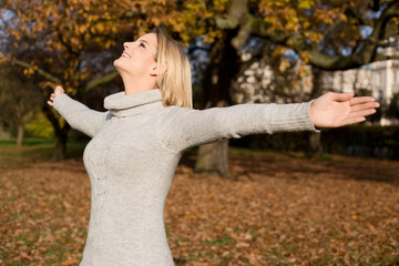 young woman feeling free in the park.
