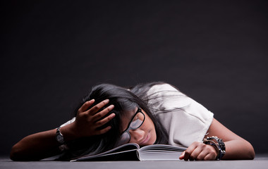 indian girl sleeping tired of studying