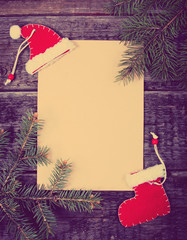 Card with Christmas decorations on wooden background