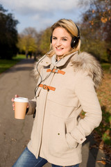 young woman with coffee and headphones.