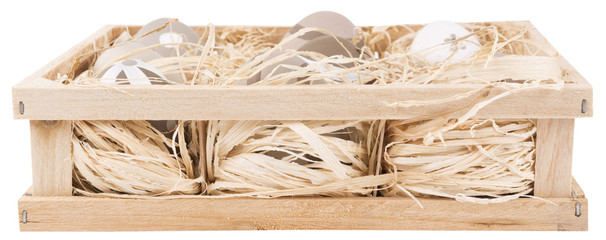 painted eggs in a wooden crate isolated