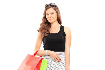 Young girl holding shopping bags
