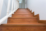 wooden staircase made from laminate wood in white modern house - 74122946