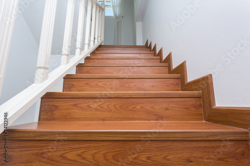 Leinwandbild Motiv wooden staircase made from laminate wood in white modern house