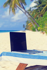 laptop on chair in beach vacation