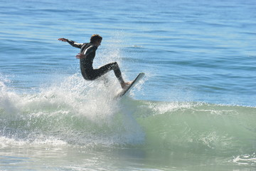 A Surfer at Malibu Beach, California