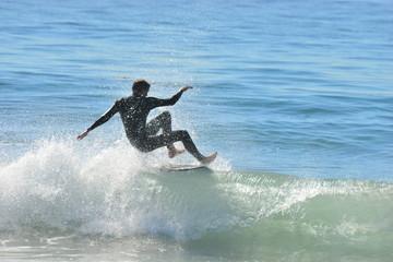 A Surfer at Malibu Beach, California