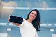 closeup mobile smartphone in hand of beautiful woman