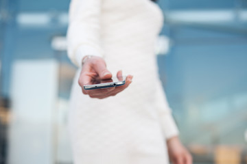 closeup mobile smartphone in hand of woman