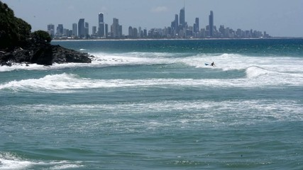 Unrecognized man canoeing in Surfers Paradise