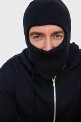 Portrait of a burglar with black jacket and balaclava