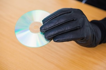Hacker holding a cd rom