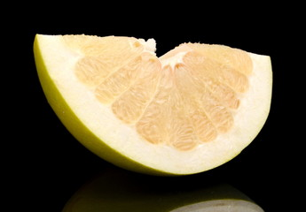 Quarter of pomelo, chinese grapefruit isolated on black