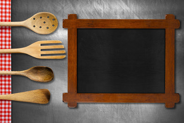 Wooden Blackboard and Kitchen Utensils