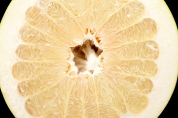 Half of pomelo, chinese grapefruit isolated on black