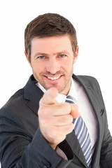 Businessman smiling and pointing