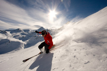 Young man skiing in powder snow