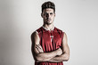 Basketball player portrait against white wall background.