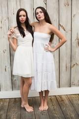 Pretty friends posing in white dresses