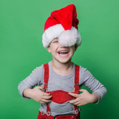 Funny little boy with Santa Claus hat laugh. Christmas
