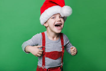 Beautiful little boy with Santa Claus hat laugh. Christmas