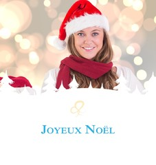 Composite image of festive blonde presenting with hand