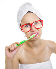Glum woman brushing teeth