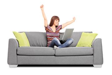 Joyful woman working on laptop