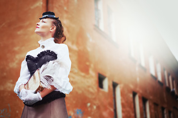 Beautiful redhair woman in vintage clothes