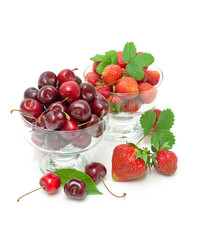 Fresh strawberries and juicy cherry isolated on a white backgrou