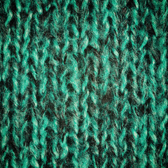 Bright green wool knitted background