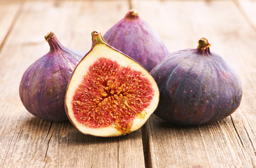 Fresh figs on wooden table