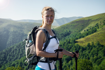 Portrait of happy hiking female