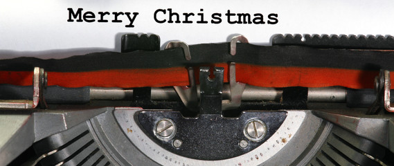 Typewriter Types MERRY CHRISTMAS  Closeup with black ink