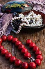 coral beads strewn with autumn leaves