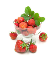 juicy strawberries in a glass bowl isolated on white background