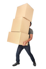 Man Holding some heavy Stack Of Cardboard Boxes