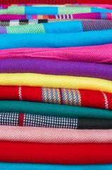 Colourful handmade scarfs close-up