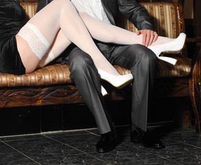 girl in white stockings seduces man indoors.