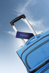 First Class. Blue suitcase with label