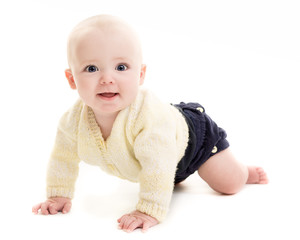 Blue Eyed Baby Boy Crawling On A White Background