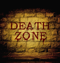 death zone blood text at the brick wall with dim light