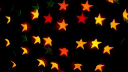 star-shaped color light blinking on black background