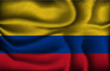 crumpled flag of Colombia a light background