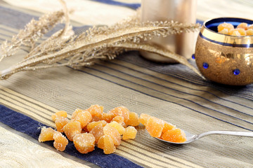Candied ginger in Christmas atmosphere
