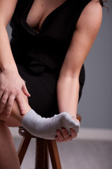 woman holding up her aching foot